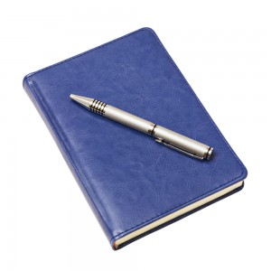 Blue journal with pen image
